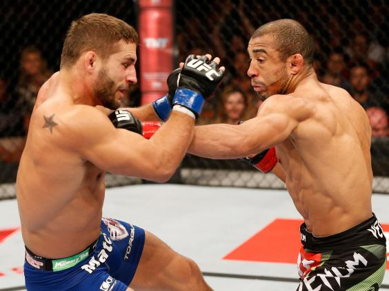 Jose-Aldo-punches-Chad-Mendes-during-UFC-179.jpg