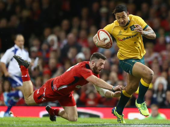 Israel-Folau-escapes-the-challenge-of-Wales'-Alex-Cuthbert-to-score-Australia's-first-try-on-Saturday.jpg