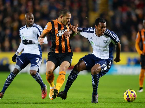 Liam-Rosenior-of-Hull-City-and-Andre-Wisdom-of-West-Brom-compete-for-the-ball.jpg