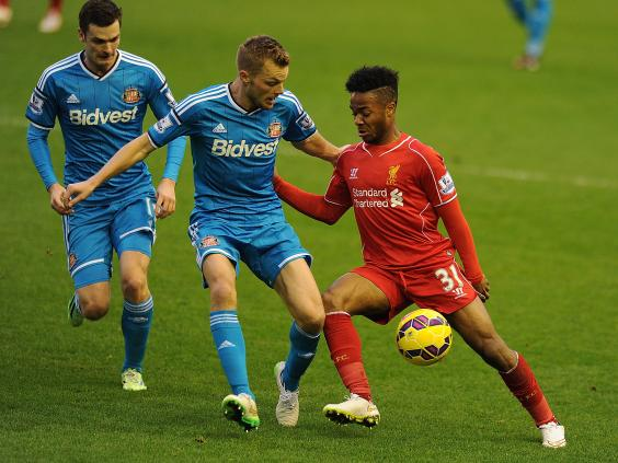 Raheem-Sterling-of-Liverpool-tussles-with-Sebastian-Larsson-of-Sunderland.jpg