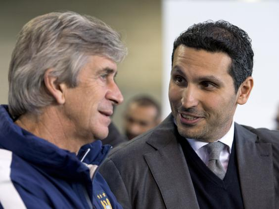 Manchester-City's-Emirati-chairman-Khaldoon-al-Mubarak-(R)-chats-with-Manchester-City's-Chilean-manager-Manuel-Pellegrini.jpg
