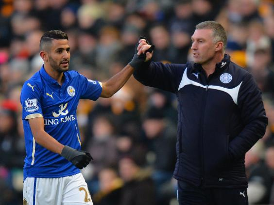 Nigel-Pearson,-manager-of-Leicester-City-congratulates-Riyad-Mahrez-of-Leicester-City-on-the-scoring-the-opening-goal.jpg