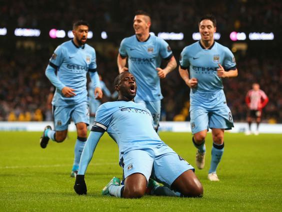 Yaya-Toure-of-Manchester-City-celebrates-the-opening-goal.jpg