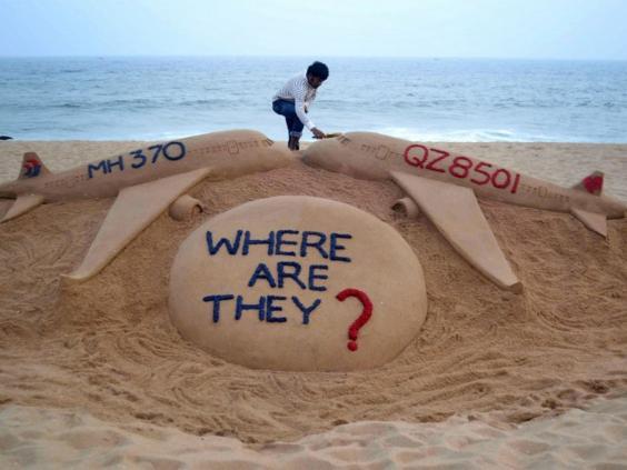 mh370-air-asia-sand.jpg