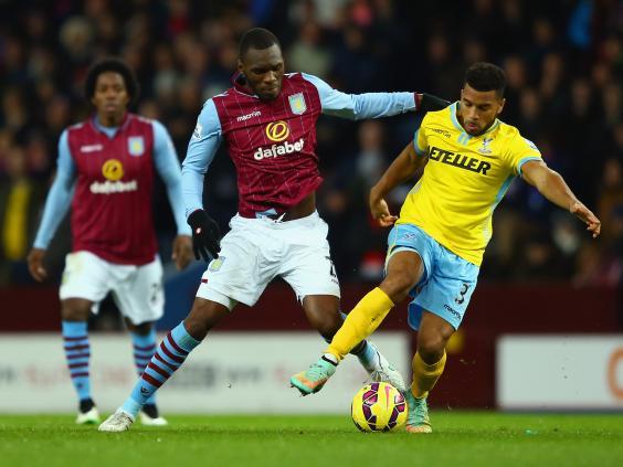 Christian-Benteke-of-Aston-Villa-and-Adrian-Mariappa-of-Crystal-Palace-battle-for-the-ball.jpg