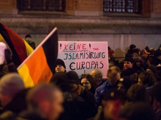 Germany anti-Islam protests: Biggest Pegida march ever in ...  Germany anti-Is...