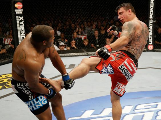 Frank-Mir-kicks-Daniel-Cormier-in-their-heavyweight-bout---Ezra-Shaw-Zuffa-LLC.jpg