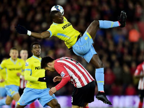 Yannick-Bolasie-of-Crystal-Palace-and-Maya-Yoshida-of-Southampton-compete-for-the-ball.jpg