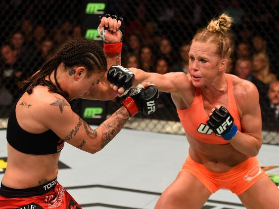 Holly-Holm-punches-Raquel-Pennington---Josh-Hedges-Zuffa-LLC.jpg