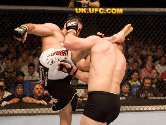 Gabriel-Gonzaga-(black-white-shorts)-head-kicks-Mirko-Crocop---Josh-Hedges-Zuffa-LLC.jpg