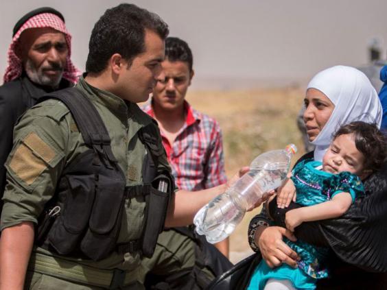 Kurdish-Peoples-Army-Reuters.jpg