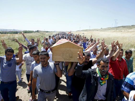 30-Kurdish-Funeral-Reuters.jpg