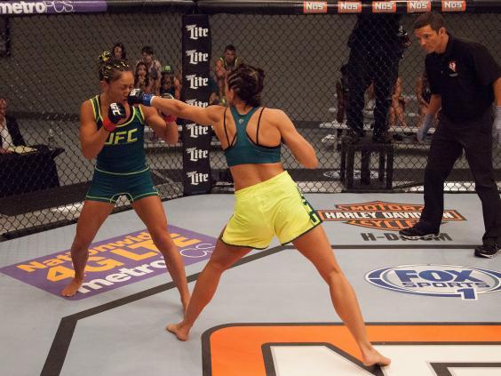 Jessica-Penne-punches-team-Pettis-fighter-Carla-Esparza---Brandon-Marcus-Zuffa-LLC.jpg