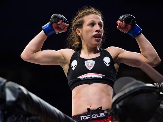 Joanna-Jedrzejczyk-celebrates-after-defeating-Esparza---Josh-Hedges-Zuffa-LLC.jpg