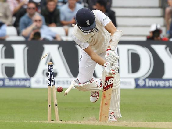Englands-Mark-Wood-loses-his-wicket-bowled-out-by-Australias-Mitchell-Starc.jpg