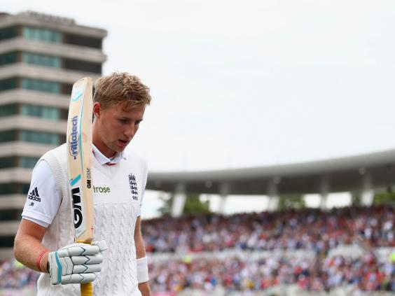 Joe-Root-of-England-raises-his-bat-as-he-leave-the-ground-after-being-dismissed-for-130-runs-by-Mitchell-Starc.jpg