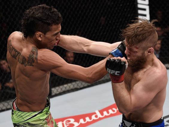 Charles-Oliveira-and-Nick-Lentz-exchange-punches---CREDIT-Buda-Mendes-Zuffa-LLC.jpg