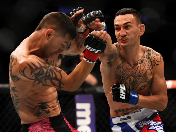 Max-Holloway-punches-Cub-Swanson---CREDIT-Jeff-Bottari-Zuffa-LLC.jpg