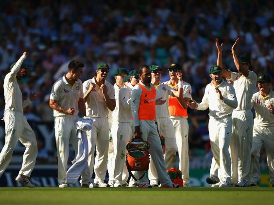 Mitch-Marsh-of-Australia-and-team-mates-celebrates-after-taking-the-wicket-of-Joe-Root.jpg