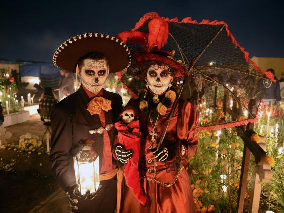 a couple celebrate mexicos day of the dead holiday - Where Does The Halloween Celebration Come From
