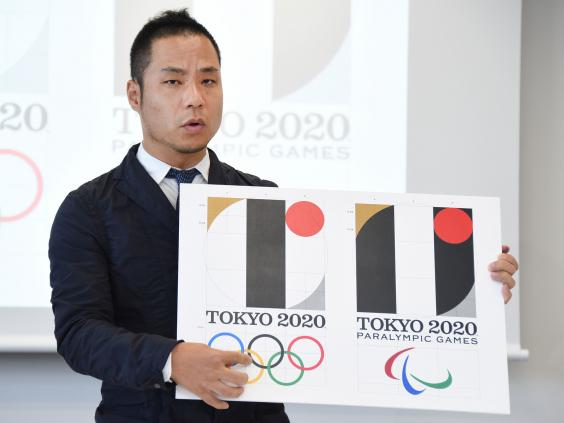 Tokyo-Olympic-logo-designer-Kenjiro-Sano-explains-his-design-during-a-press-conference.jpg