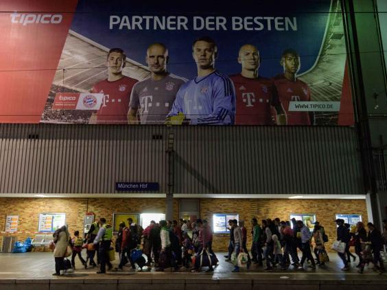 bayern-refugees-epa.jpg