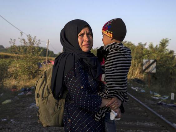 14-Refugee-Woman-Reuters.jpg