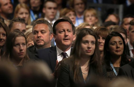 David Cameron watches on as George Osborne delivers his keynote speech to the Tory party conference