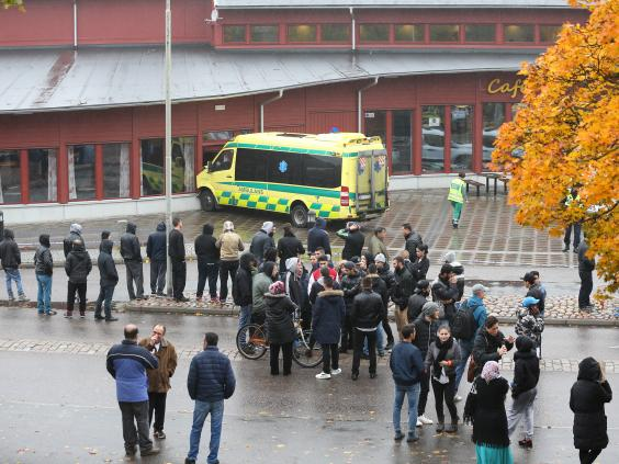 Sweden school attack: Sword-wielding man 'posed for pictures with ...
