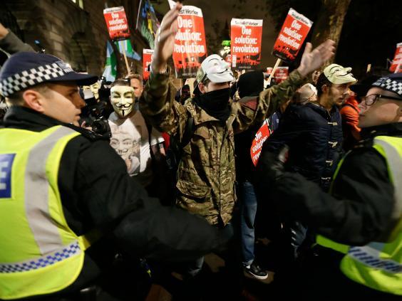5-masked-demonstrators-AP.jpg