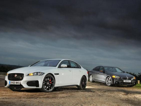 jaguar xf vs bmw 5 series: two big-hitters face off | the independent
