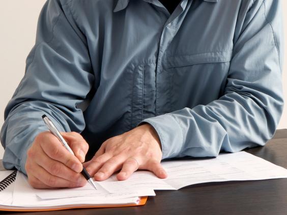 teacher-grading-papers-generic.jpg