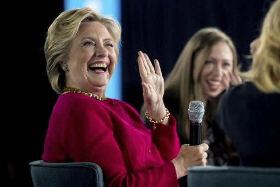 Clinton reaches out to women while Trump defends taxes