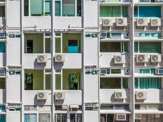 air conditioning units on an apartment block in hong kong getty