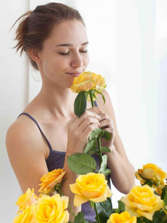 woman-smelling-flowers.jpg
