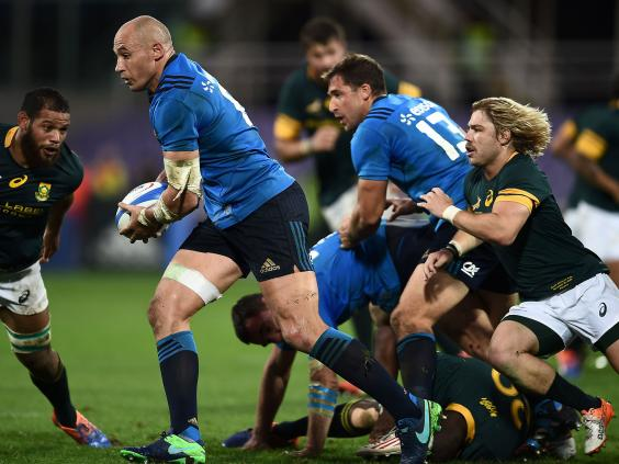 Sergio Parisse escapes with the ball to lead an Italian charge