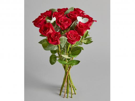 one for traditionalists this no fuss bouquet includes a dozen red freedom roses complemented by fragrant eucalyptus cinerea and robusta whose sage green