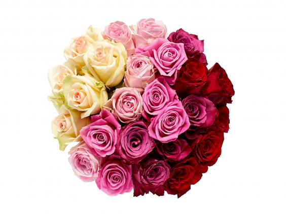 flowers to have a modern edge then feast your eyes on this tightly arranged and beautifully creative combo of 24 variously coloured roses whose shades
