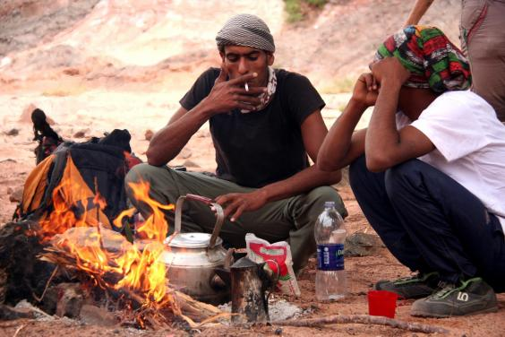 sure-footed-jordanians-mohamed-and-mohamed-engage-in-sweet-tea-and-cigarettes-after-the-days-walking-is-done.jpg