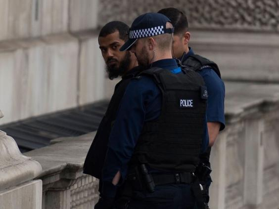 Woman shot by police during anti-terror raid in London