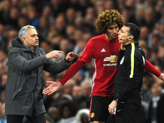 Fellaini sees red as United hold on for goalless draw at City
