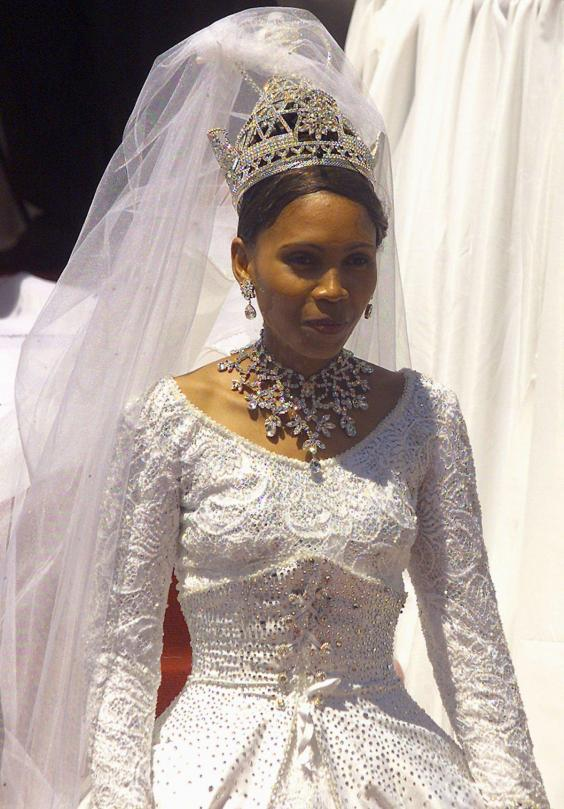 15 photos that show what royal wedding dresses look like around the 23 year old wife of the lesotho king letsie iii karabo motsoeneng leaves the royal wedding ceremony at the lesotho independent stadium in maseru in junglespirit Image collections