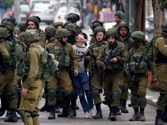 palestinian-boy-israeli-forces.jpg