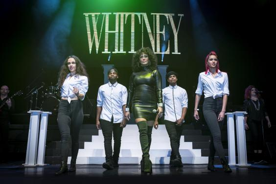 whitney-houston-photo-black-leather-dress-with-group-walking-8.8.17.jpg