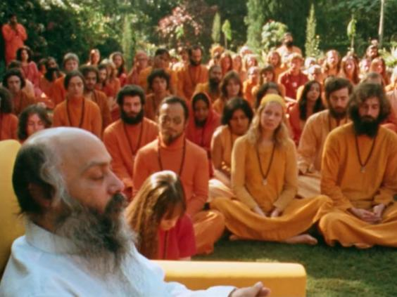 ajneesh, also known as Osho, with his 'Orange People' followers (Netflix)
