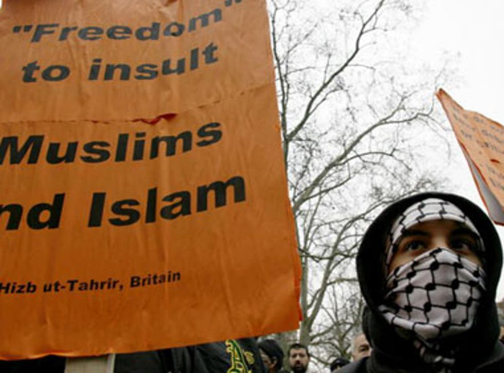 A Muslim protester joins a demonstration outside the Danish embassy in London