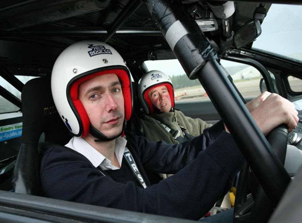 Rob Sharp at the helm in one of the two Honda Civic Hybrids converted for motorsport,with Bill Meeson (right) as navigator at Millbrook test circuit in Bedfordshire © John Lawrence