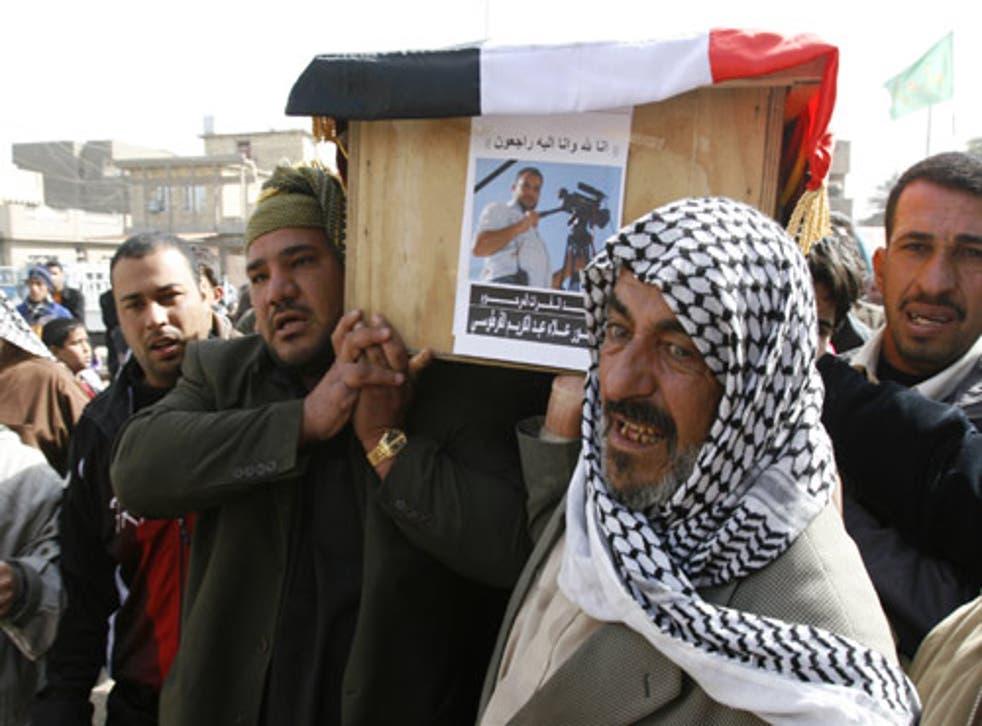 Relatives carry the coffin of Alaa Abdul-Karim al-Fartoosi, a journalist killed by a roadside bomb in Baghdad