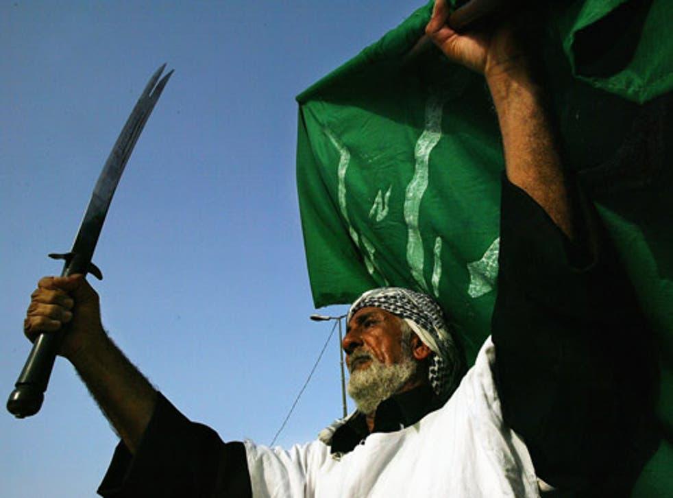 A man takes part in a ceremony celebrating the establishment of Muqtada al-Sadr's Mehdi Army