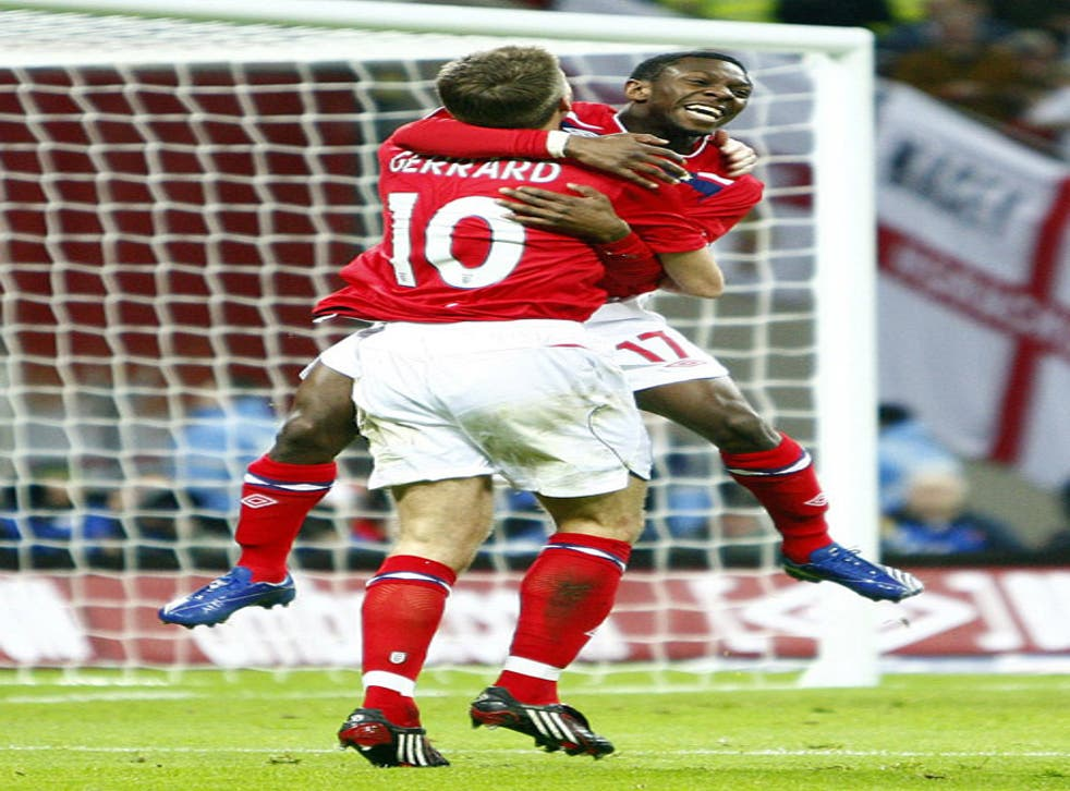 Shaun Wright-Phillips celebrates with captain Steven Gerrard after scoring England's winner at Wembley